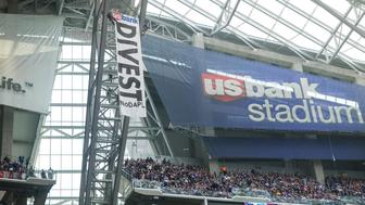 Jan 1, 2017; Minneapolis, MN, USA; Two protestors rappel from the rafters with a banner against the Dakota Pipeline  during the second quarter during a game between the Minnesota Vikings and Chicago Bears at U.S. Bank Stadium. Mandatory Credit: Brace Hemmelgarn-USA TODAY Sports