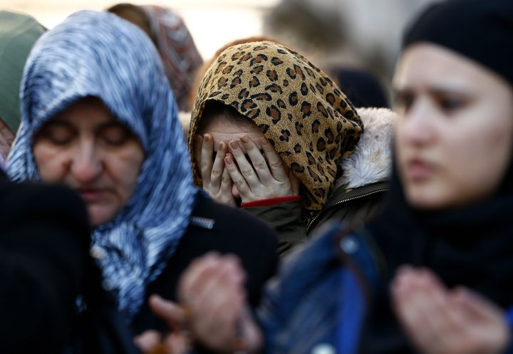 Relatives react at the funeral of Busra Kose, a victim of an attack by a gunman at Reina nightclub, in Istanbul, Turkey, Janu
