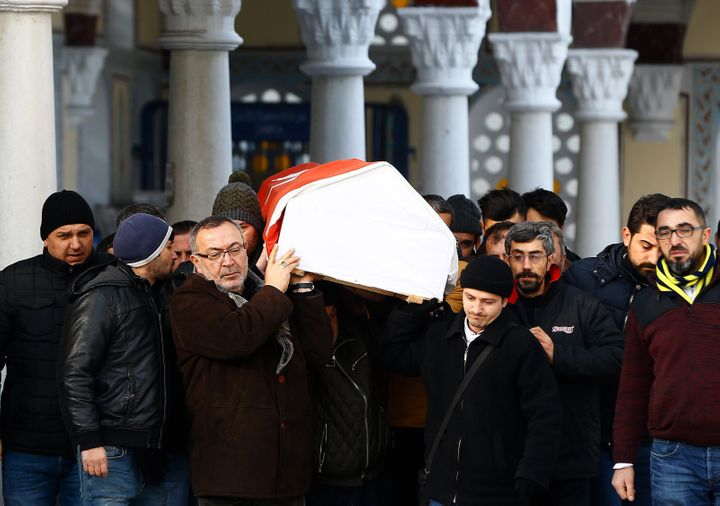 Relatives carry the coffin of Ayhan Arik, a victim of an attack by a gunman at Reina nightclub, during his funeral in Istanbu