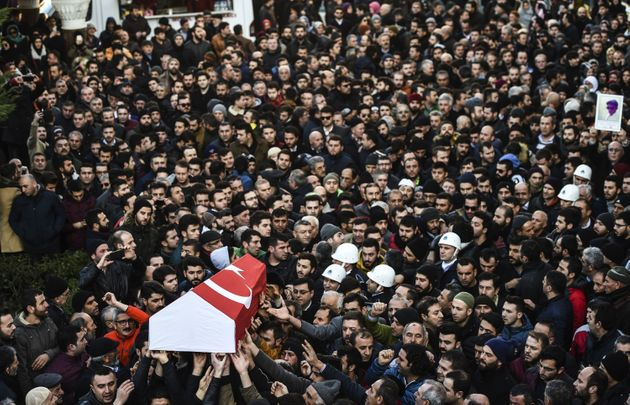 People carry the coffin of Yunus Gormek, 23, one of the victims of the Reina night club attack, during...