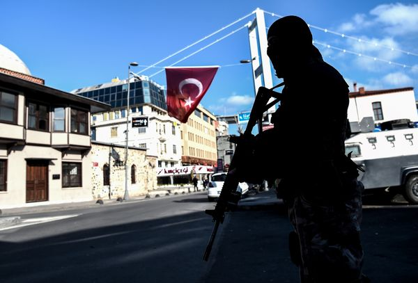 A Turkish special force police officer stands guard at ortakoy district near the Reina night club.
