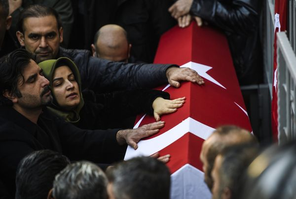 Relatives of security member Fatih Cakmak, 35, who died in the Reina night club attack, mourn during the funeral ceremony.