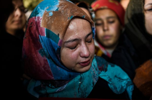 Relatives of Yunus Gormek, 23, one of the victims of the Reina night club attack, mourn.