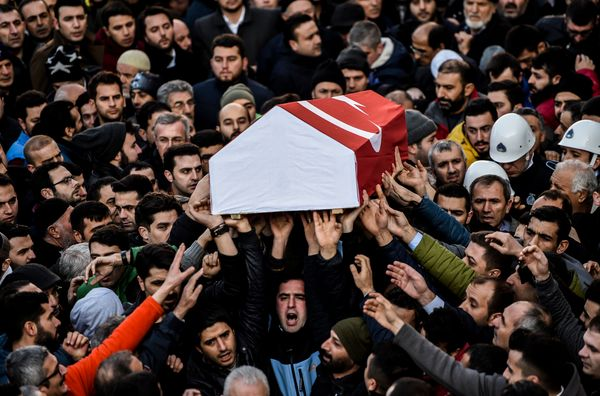 People carry the coffin of Yunus Gormek, 23, one of the victims of the Reina night club attack.