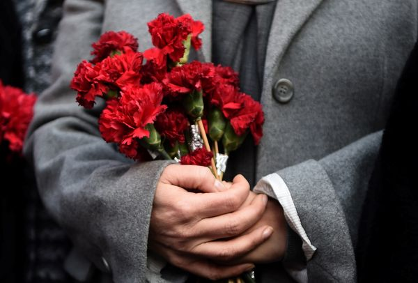 A woman holds flowers in front of the Reina night club, on January 2, 2017 in Istanbul.