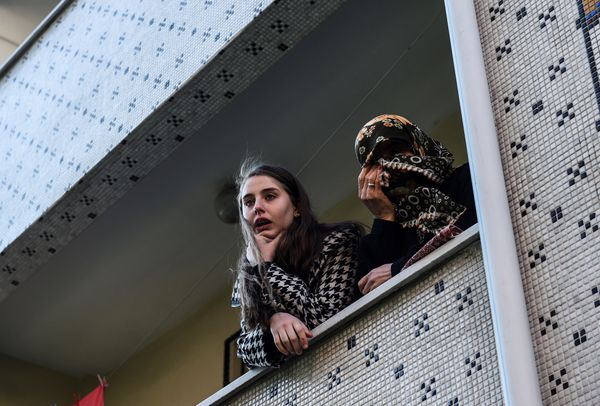 Relatives of security member Fatih Cakmak, one of the victims of the Reina night club attack mourn during his funeral ceremon