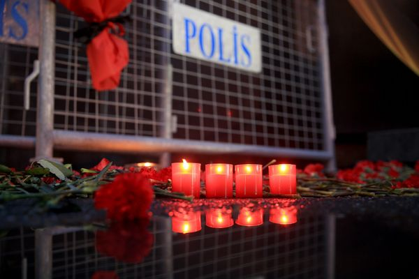 Flowers and candles are placed in front of the night club to pay tribute to victims.