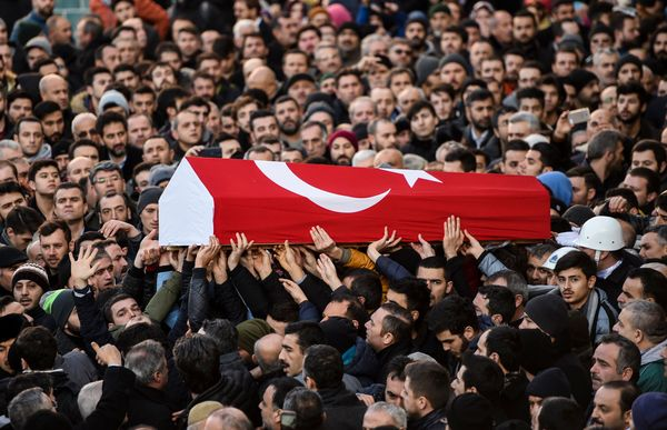 People carry the coffin of Yunus Gormek, 23.