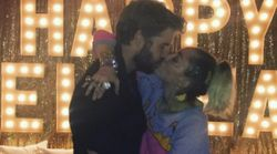 Miley Cyrus And Liam Hemsworth Smooch On NYE, And The World