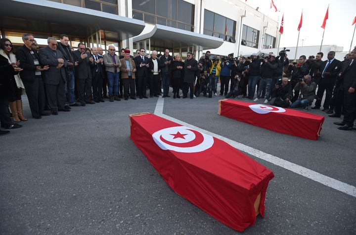 Mourners pray around the coffins of a Franco-Tunisian couple who were victims of the attack at the Reina nightclub.
