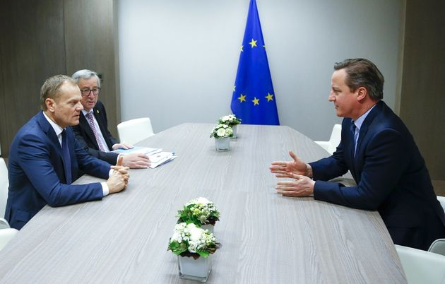 British Prime Minister David Cameron, right, hopes the threat of the United Kingdom's departure from...