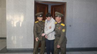 PYONGYANG, March 16, 2016 -- American student Otto Frederick Warmbier, center, is escorted out of the courtroom after his trial in Pyongyang, capital of the Democratic People's Republic of Korea, on March 16, 2015. American student Otto Frederick Warmbier, held by the Democratic People's Republic of Korea, was sentenced to 15 years of hard labor for anti-DPRK crimes, the Supreme Court of the DPRK announced Wednesday. (Xinhua/Lu Rui via Getty Images)