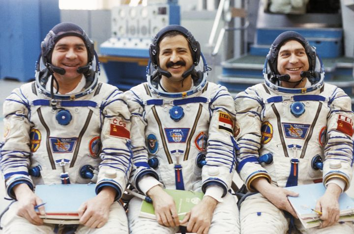 Syria's first and only spaceman, Muhammed Faris (C), is now living as a refugee in Turkey.