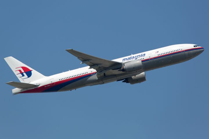 A Malaysia Airlines Boeing 777, the sister airplane of the missingaircraft, takes off in Frankfurt, Germany. A piece of