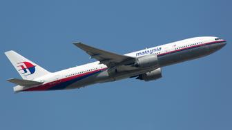 FRANKFURT - JUNE 19: A Malaysia Airlines Boeing 777 takes off on June 19, 2013 in Frankfurt, Germany. The aircraft is the sister airplane of the crashed planes with the registration 9M-MRO and 9M-MRD.