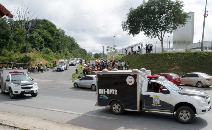 Vans of the Legal Medicine Institute (IML) carrying bodies of inmates killed during a riot, leave the Anisio Jobim Penitentia