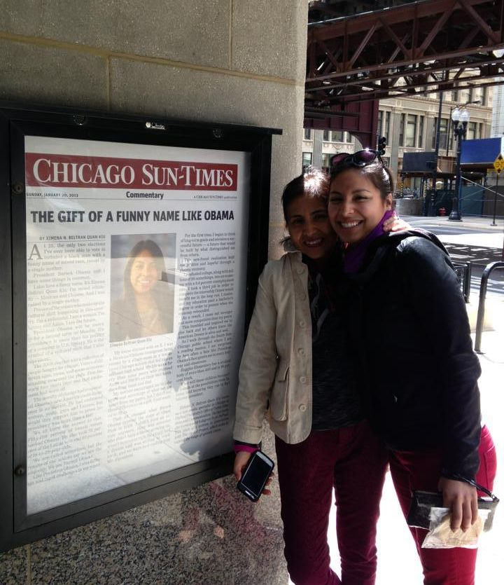 Me and my mom posing with the blown up version of my 2013 op-ed: 'The Gift of Funny Name Like Obama,' on display at DePaul's