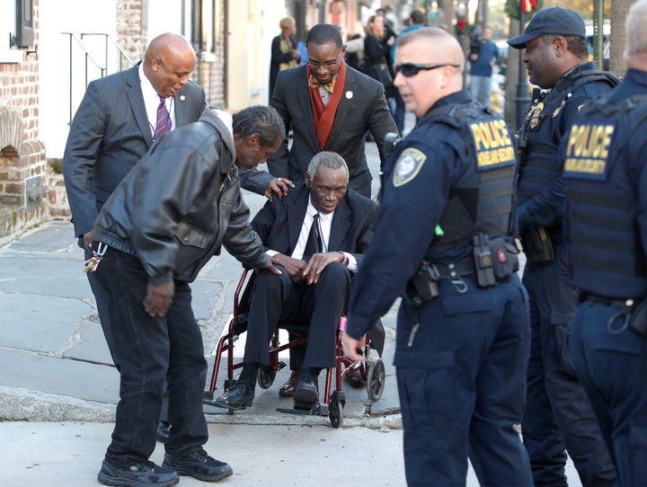 John Pinckney (in wheelchair), the father ofDylann Roof shooting victim Rev. Clementa Pinckney, leaves the Charleston F