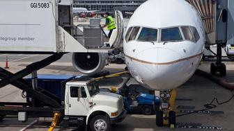 Jetliner serviced at gate_Washington Dulles International Airport_Washington DC