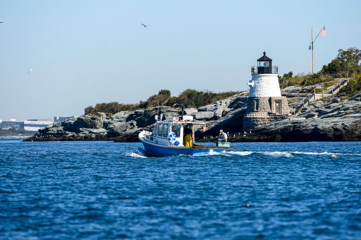 A local fisherman near a lighthouse in Newport, Rhode Island. The Ocean State recently banned the sale and ownership of shark