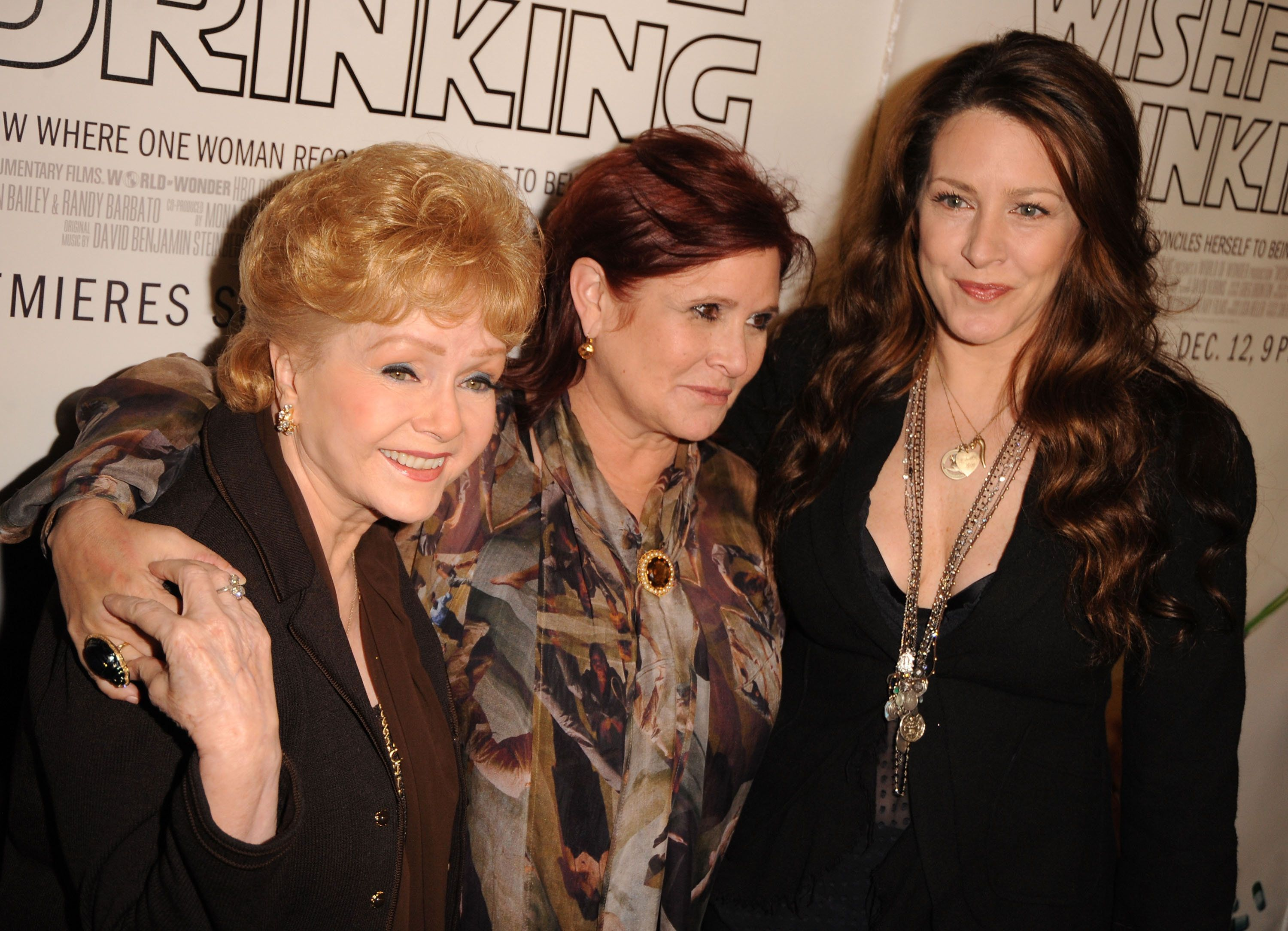 Joely Fisher (right) spent time with Debbie Reynolds (left) in the hospital at Carrie Fisher's (center)...