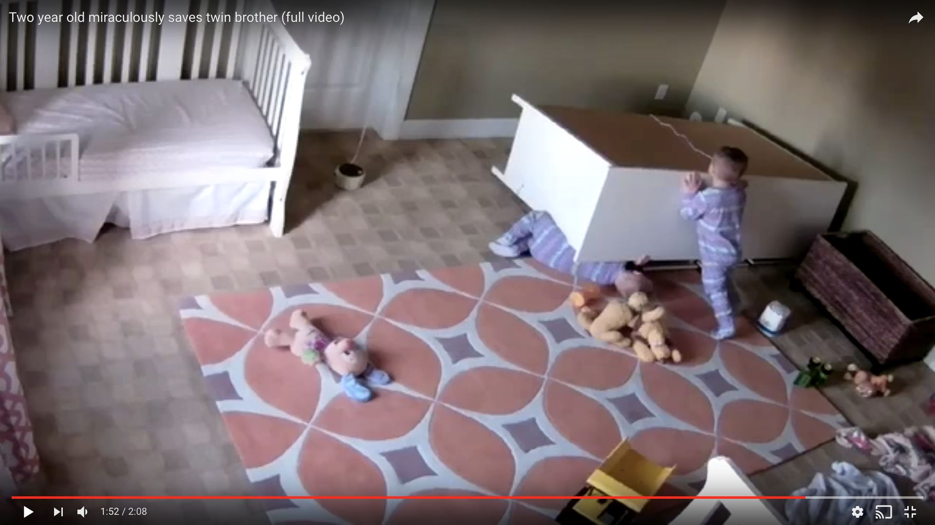 The 2-year-old boy is seen pushing a dresser off of his twin brother after it toppled on him in their...