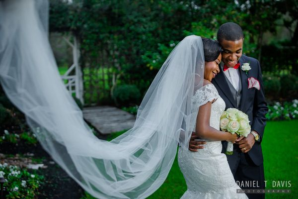 """Tinu and Ini were married in a lush green garden in Houston, Texas."" -- <i>Daniel T Davis</i>"