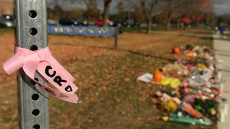 DANVERS, MA - OCTOBER 25: A pink ribbon with 'CR' and a heart for Danvers High School Math teacher Colleen Ritzer is tied to a pole in front of the high school on October 25, 2013,  the first day school opened after Philip Chism, 14, was charged with killing the beloved teacher. (Photo by Essdras M Suarez/The Boston Globe via Getty Images)