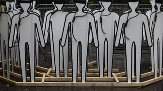 Cardboard cut outs made to resemble humans stand with nooses and blind folds as demonstrators protest Iranian President Hassan Rouhani outside the United Nations on September 25, 2014 during the 69th session of the United Nations General Assembly in New York. Rouhani vowed at the UN Thursday that Tehran would continue talks on securing a nuclear deal in good faith with Western powers, warning against any delay on resolving the issue. AFP PHOTO/Joshua Lott        (Photo credit should read Joshua LOTT/AFP/Getty Images)