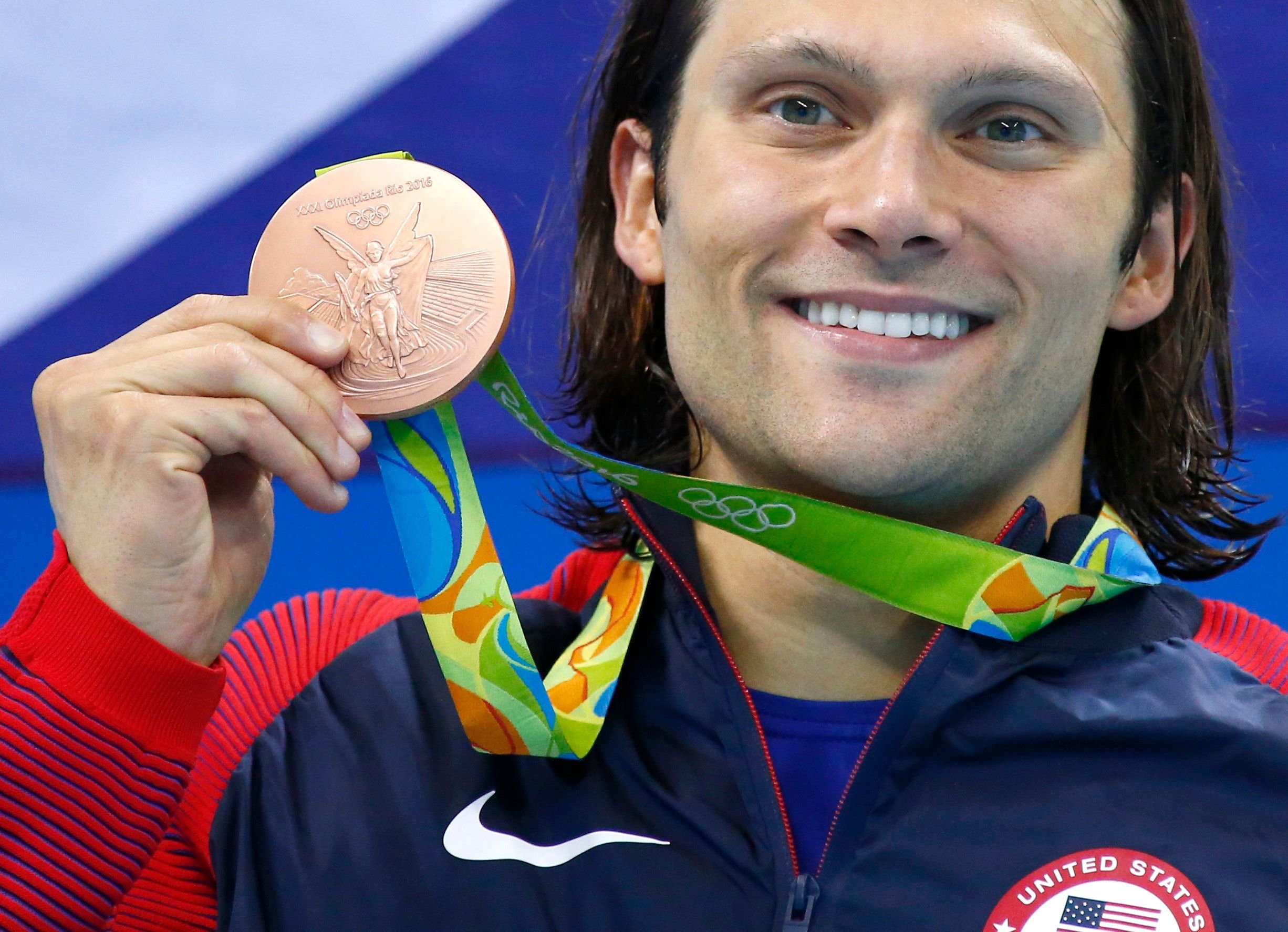 2016 Rio Olympics - Swimming - Victory Ceremony - Men's 100m Breaststroke Victory Ceremony - Olympic Aquatics Stadium - Rio de Janeiro, Brazil - 07/08/2016.  Cody Miller (USA) of USA poses with his medal   REUTERS/David Gray  FOR EDITORIAL USE ONLY. NOT FOR SALE FOR MARKETING OR ADVERTISING CAMPAIGNS.