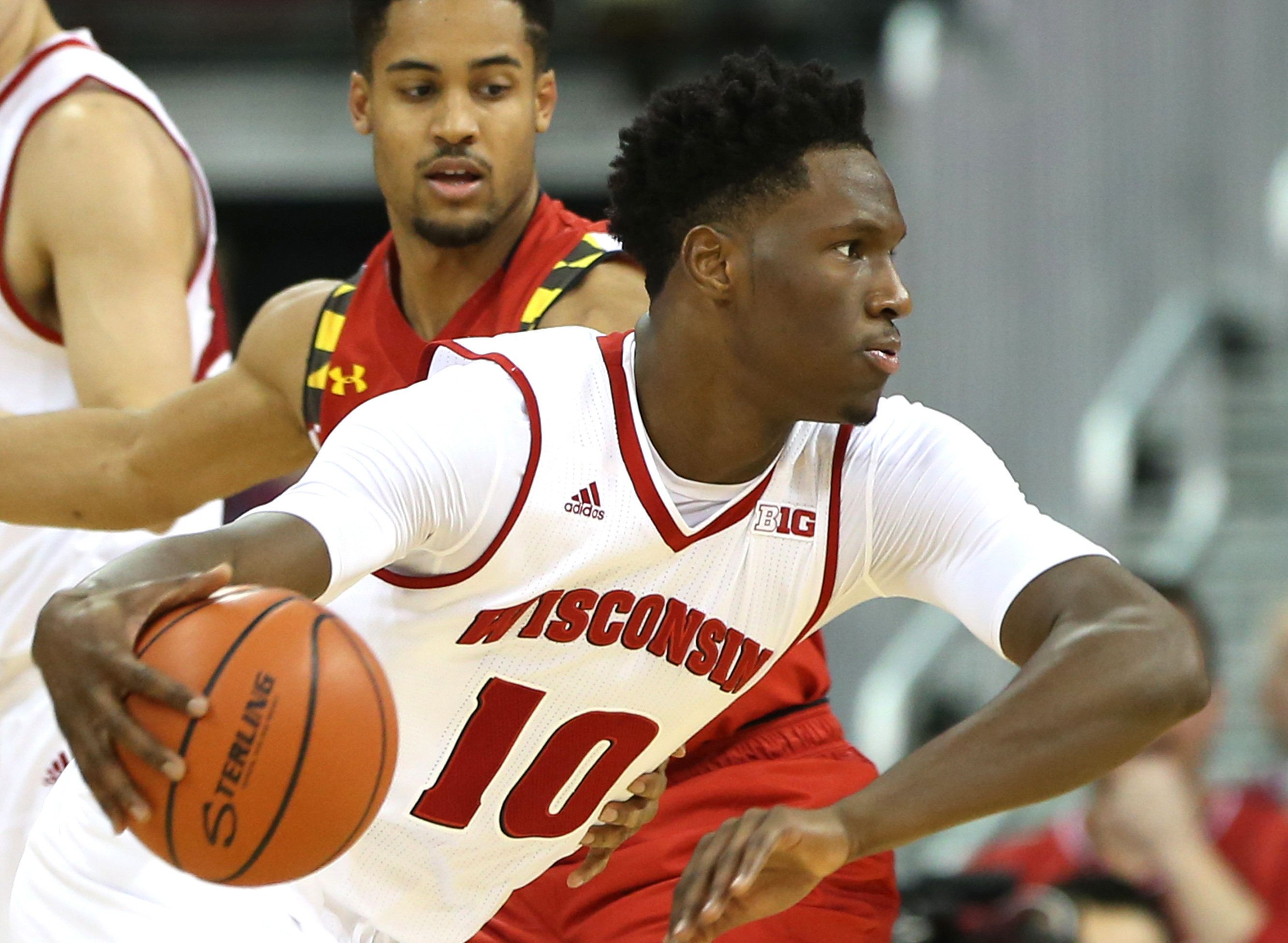 Jan 9, 2016; Madison, WI, USA; Wisconsin Badgers forward Nigel Hayes (10) drives the ball against Maryland Terrapins guard Melo Trimble (rear) at the Kohl Center. Maryland defeated Wisconsin 63-60. Mandatory Credit: Mary Langenfeld-USA TODAY Sports