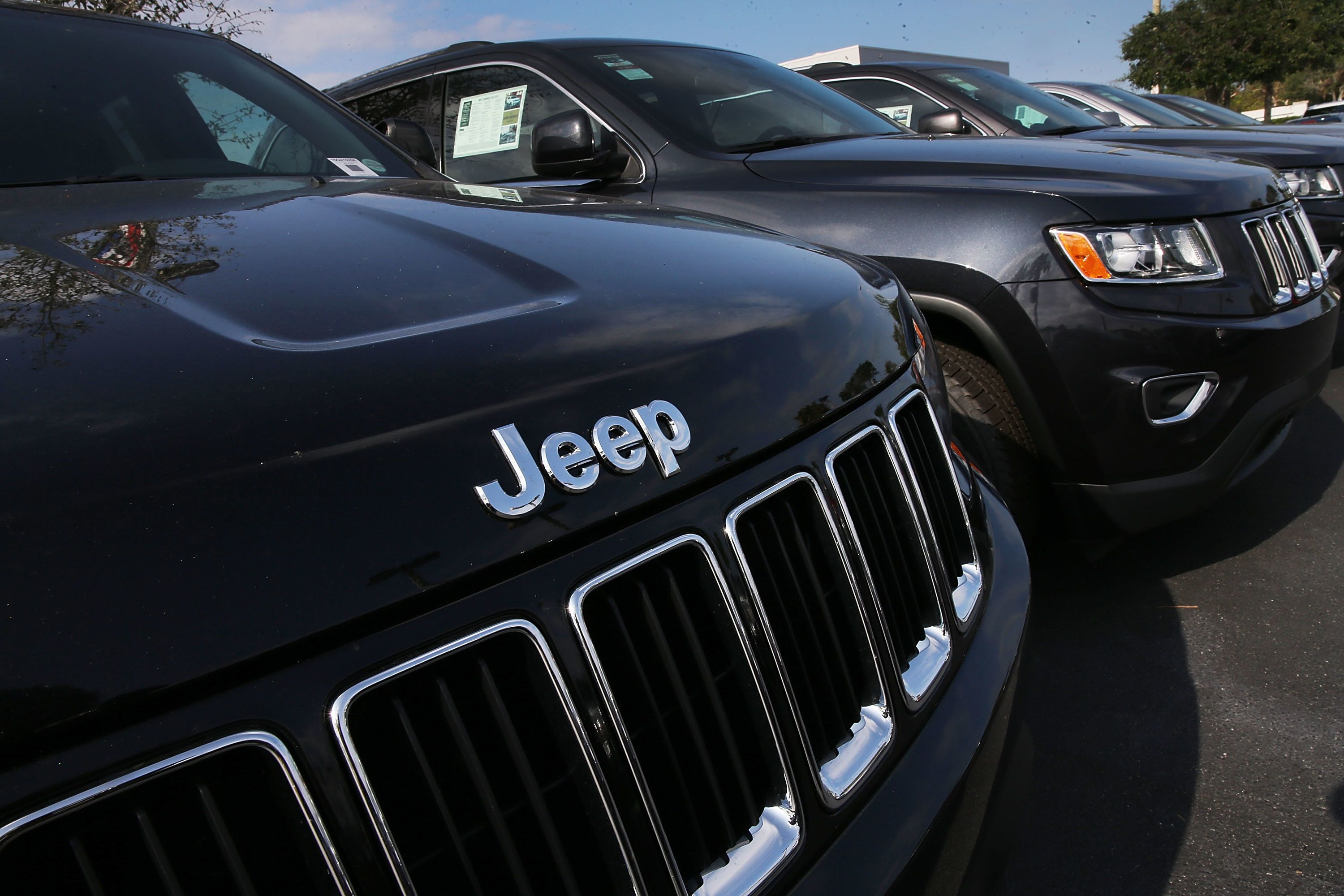 MIAMI, FL - APRIL 22:  2015 Jeep Grand Cherokee vehicles are seen on a sales lot as Fiat Chrysler Automobiles announced that it is recalling more than 1.1 million cars and SUVs worldwide because the vehicles may roll away after drivers exit the vehicles on April 22, 2016 in Miami, Florida. The recall covers the 2012-2014 Dodge Charger and Chrysler 300 sedans and 2014-2015 Jeep Grand Cherokee sport utility vehicles.  (Photo by Joe Raedle/Getty Images)