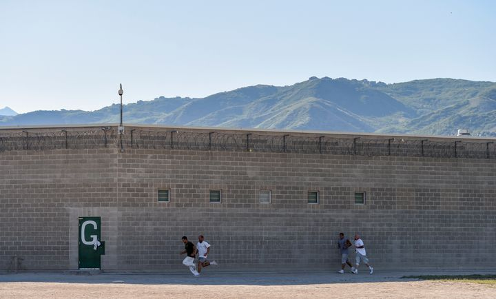 Inmates run the yard during the Addict II Athlete program at the Utah State Prison - Promontory Facility on June 19, 2015 in
