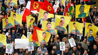 Protesters hold flags showing jailed PKK leader (Kurdistan Workers' Party) Abdullah Ocalan during a demonstration against Turkish President Tayyip Erdogan in central Brussels, Belgium, November 17, 2016. REUTERS/Yves Herman