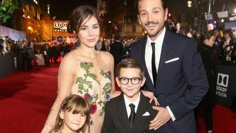 HOLLYWOOD, CA - DECEMBER 10:  Actor Diego Luna (R) with family at The World Premiere of Lucasfilm's highly anticipated, first-ever, standalone Star Wars adventure, 'Rogue One: A Star Wars Story' at the Pantages Theatre on December 10, 2016 in Hollywood, California.  (Photo by Jesse Grant/Getty Images for Disney)