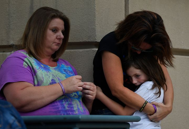Heather Dearman, far right, and her daughter Aubry, 8, cousins of Aurora Theater shooting victim Veronica Moser-Sullivan, hug