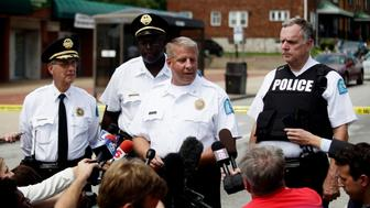 St. Louis Police Chief Sam Dotson speaks to reporters outside Golden Shears Barber & Beauty Shop where officers shot a man holding a knife in St. Louis, Missouri August 19, 2014. Dotson told reporters during a news conference that the suspect robbed the shop and then approached police officer with the knife forcing them to kill him. REUTERS/Joshua Lott (UNITED STATES - Tags: CRIME LAW CIVIL UNREST)
