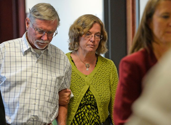 Robert and Arlene Holmes, parents of Aurora theater shooting suspect James Holmes, walk from the courtroom at the Arapahoe Co