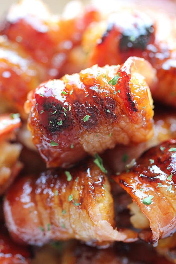 "<strong>Get the <a href=""http://damndelicious.net/2014/07/26/bacon-wrapped-tater-tot-bombs/"" target=""_blank"">Bacon Wrapped Ta"