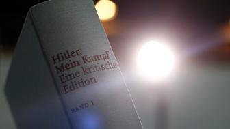 A copy of the book 'Hitler, Mein Kampf. A Critical Edition' is displayed for media prior to a news conference in Munich, Germany January 8, 2016. For the first time since Adolf Hitler's death, Germany is publishing the Nazi leader's political treatise 'Mein Kampf' ('My Struggle') unleashing a highly charged row over whether the text is an inflammatory racist diatribe or a useful educational tool.   REUTERS/Michael Dalder
