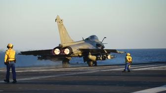 The first Rafale fighter jet is ready to be catapulted from the French aircraft carrier Charles de Gaulle at the start of the Operation Arromanches 3 on September 30, 2016 in east Mediterranean sea. French fighter jets took off from the aircraft carrier Charles de Gaulle for an operation against the Islamic State group in its Iraqi stronghold of Mosul, an officer said. The Charles de Gaulle is on its third mission since February 2015 in support of the US-led coalition fighting IS in Iraq and Syria. The latest comes with Iraqi forces poised for an assault on Mosul with coalition air and artillery support. / AFP / Eric FEFERBERG        (Photo credit should read ERIC FEFERBERG/AFP/Getty Images)