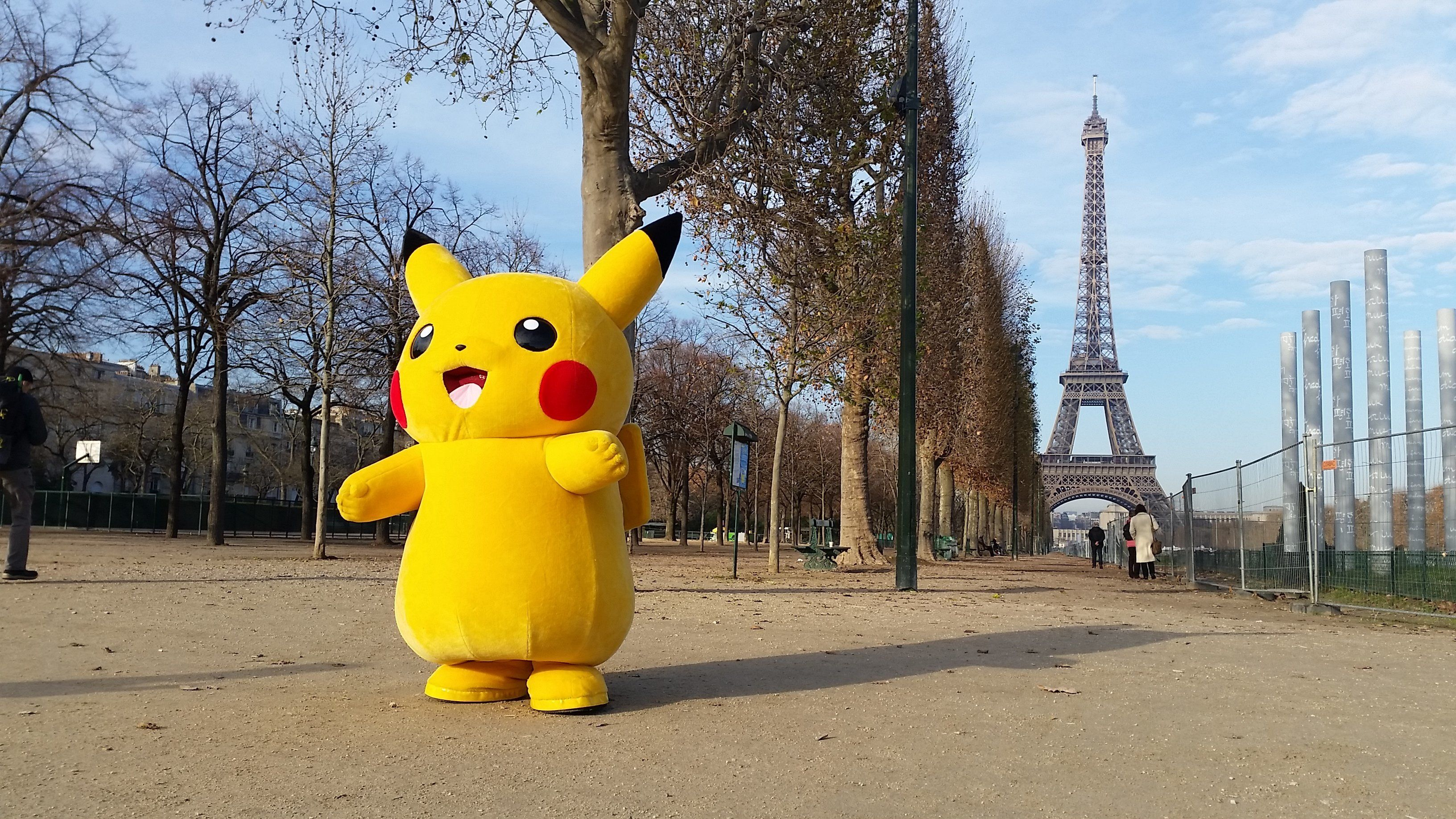 A person wearing a costume of Pikachu, a Pokemon character, walks on the Champs de Mars near the Eiffel Tower in Paris, on December 16, 2016. / AFP / Ludovic MARIN        (Photo credit should read LUDOVIC MARIN/AFP/Getty Images)