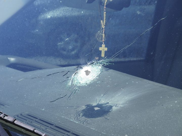 A bullet hole is shown in a windshield of a car that was traveling on Interstate 10 in Phoenix, Arizona in the handout photo