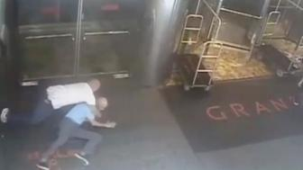 Ex-tennis star James Blake is shown tackled by a NYPD officer James Frascatore (L) in front of the Grand Hyatt hotel in New York on September 9, 2015 in this still image from a security camera video released on September 11, 2015. The New York City Police Department on Friday released a security camera video showing Blake being tackled, thrown to the ground and handcuffed by an undercover officer in a now infamous case of mistaken identity.  REUTERS/NYPD/Handout    FOR EDITORIAL USE ONLY. NOT FOR SALE FOR MARKETING OR ADVERTISING CAMPAIGNS. THIS IMAGE HAS BEEN SUPPLIED BY A THIRD PARTY. IT IS DISTRIBUTED, EXACTLY AS RECEIVED BY REUTERS, AS A SERVICE TO CLIENTS