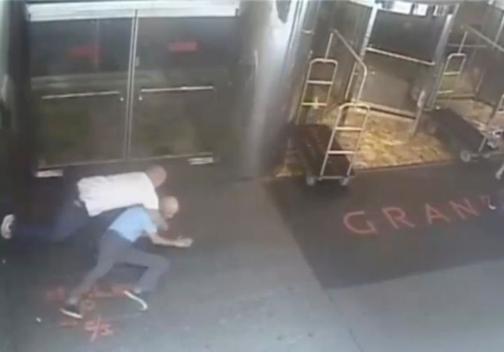 Ex-tennis star James Blake is shown tackled by a NYPD officer James Frascatore (L) in front of the Grand Hyatt hotel in New Y