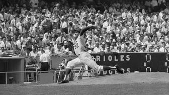 (Original Caption) 10/6/1966-Los Angeles, CA: Sandy Koufax, the LA Dodgers' great left-hander, rears bac to let one go in the first inning against the baltimore Orioles, in the second game of the World Series. koufax set a World Series record for scoreless innings early in the game.