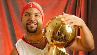 SANTA MONICA, CL - MARCH 19: Actor/Rapper Ice Cube poses with the Larry O'Brien trophy prior to the NBAE Entertainment League All-Star game in Santa Monica, California. NOTE TO USER: User expressly acknowledges and agrees that, by downloading and/or using this photograph, User is consenting to the terms and conditions of Getty Images License Agreement. (Photo by Juan Ocampo/NBAE via Getty Images)