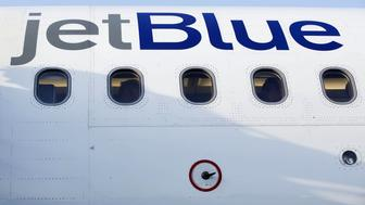 Travelers are seen through the windows of a JetBlue Airways Corp. Airbus Group SE A320 aircraft on the tarmac at Long Beach Airport (LGB) in Long Beach, California, U.S., on Monday, April 25, 2016. JetBlue Airways Corp. is scheduled to release earnings figures on April 26. Photographer: Patrick T. Fallon/Bloomberg via Getty Images