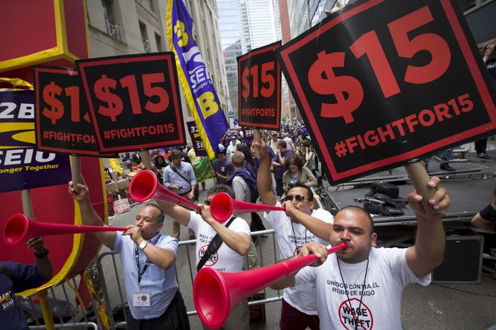 People rally for the $15 minimum wage for fast-food workers in New York.