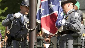 The Confederate battle flag is permanently removed from the South Carolina statehouse grounds during a ceremony in Columbia, South Carolina, U.S. on July, 10, 2015.  REUTERS/Jason Miczek/File Photo